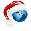 Santa hat and globe — Stock Photo