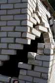 Hole wall brick house — Stock Photo