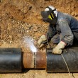 Welder working   pipeline - Stock Photo