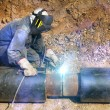 Welder working pipeline — Stock Photo #3629137