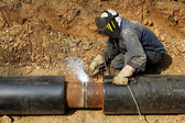 Welder working pipeline — Stock Photo