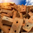 Brick red clay sun — Stock Photo
