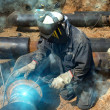 Welder working pipeline — Stock Photo #3679735