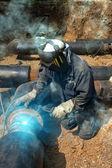 Welder working pipeline — Stock Photo