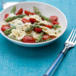Pasta with asparagus and tomatoes — Stock Photo