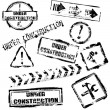 Under construction stamps — Stockvectorbeeld