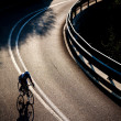 Cyclist riding along a mountain road - Stock Photo