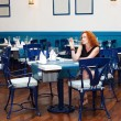 Girl in restaurant — Stock Photo