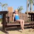 Little girl on bench — Stock Photo