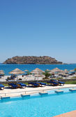 Swimming pool and beach with a view on Spinalonga Island, Crete, — Stok fotoğraf