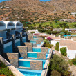 Villas with swimming pools of luxury hotel, Crete, Greece - Stockfoto