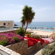 Terrace with flowers at recreation area of luxury hotel, Crete, - Stock fotografie