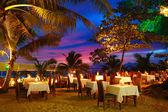 Outdoor restaurant at the beach during sunset, Phuket, Thailand — Stock Photo