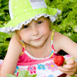 Girl eating strawberries — Stock Photo