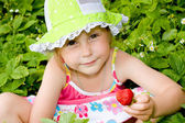 Girl eating strawberries — Stock Photo