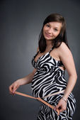 Pregnant female on a black background — Stock Photo