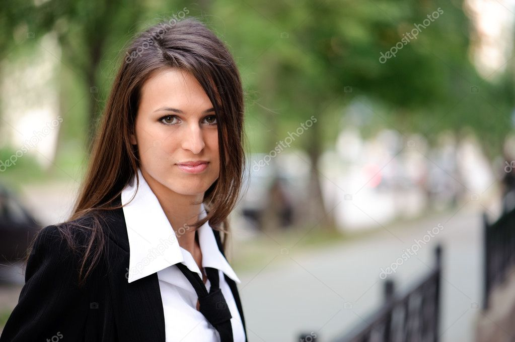 Secretary in black suit on the street — Stock Photo #2973805