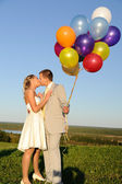Kissing wedding pair — Stock Photo