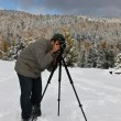 The photographer with a tripod — Stock Photo #2982485