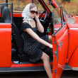 Stock Photo: Girl in old retro car