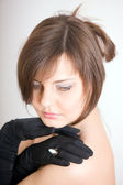 Brown-haired woman in gloves — Stock Photo
