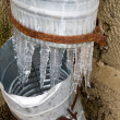 Icicles on a drainpipe - Stock Photo