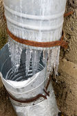 Icicles on a drainpipe — Stock Photo