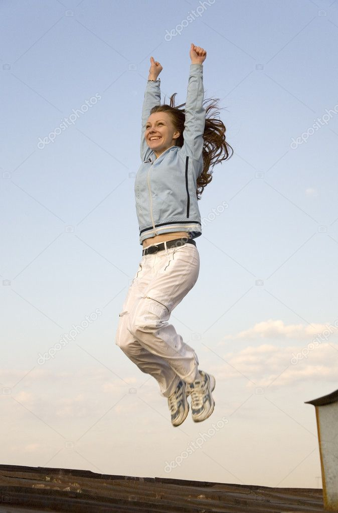 A girl jumping on the roof — Stock Photo #3502430