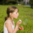 The girl and a soap bubble — Stock Photo