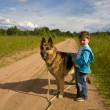 The little boy with a dog - Stock Photo