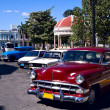 Stock Photo: Old cars and rotund, Cuba