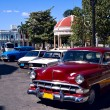 Old cars and rotunda , Cuba - Stock Photo
