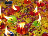 Floating candles and flower petals on water — Stock Photo