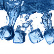 Ice cubes dropped into water with splash — Stock Photo #3156032