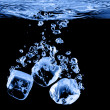 Ice cubes dropped into water with splash — Stock Photo #3156098