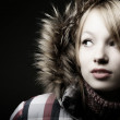 Beautiful young woman with fur coat — Stock Photo