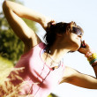 Stock Photo: Young beautiful girl with sunglasses