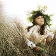 Lovely little girl in flowers wreath — Stock Photo