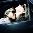 Loving couple embraces in the car. Art photo — Stock Photo