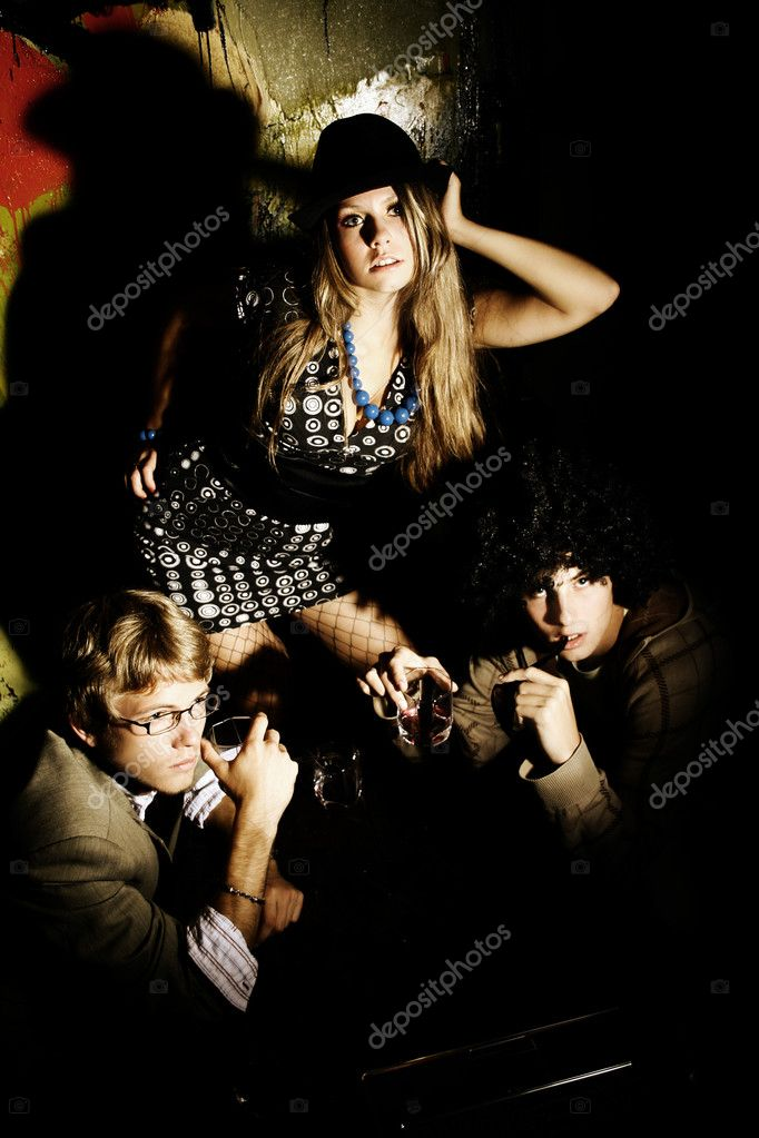 Fashion young guys and girls sitting together and having fun  — Stock Photo #3782628