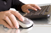 Computer mouse in hand and keyboard — Stock Photo