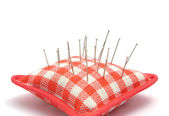 Pin cushion with several pins — Stock Photo