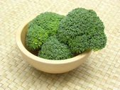 Wooden bowl with broccoli — Stock Photo