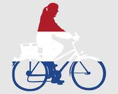 Dutch woman on bike — Stock Photo