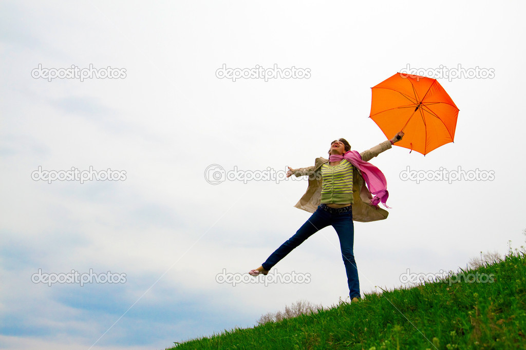 Flying women with umbrella on green grass — Stock Photo #3118361