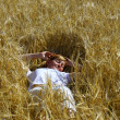 Woman in wheat — Stock Photo