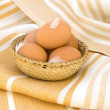 Eggs in a wicker — Stock Photo