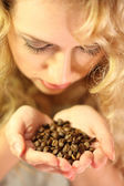Holding in hands coffee beans — Stock Photo