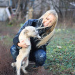 Blond girl played with small white dog — Foto Stock #2908620