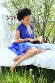Reading in the garden — Stock Photo
